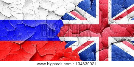 Russia flag with Great Britain flag on a grunge cracked wall