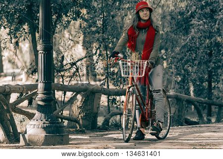Young Woman Riding Red Vintage Bike On Fall Season