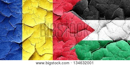 Romania flag with Palestine flag on a grunge cracked wall
