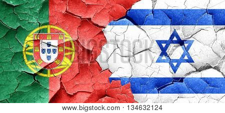 Portugal flag with Israel flag on a grunge cracked wall