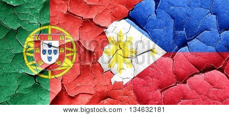 Portugal flag with Philippines flag on a grunge cracked wall