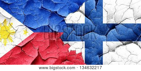 Philippines flag with Finland flag on a grunge cracked wall