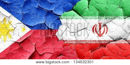Philippines flag with Iran flag on a grunge cracked wall