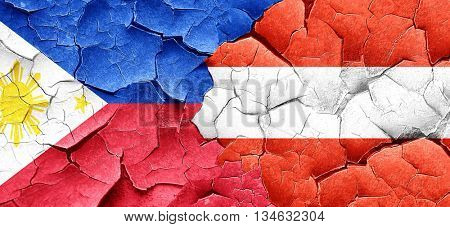Philippines flag with Austria flag on a grunge cracked wall