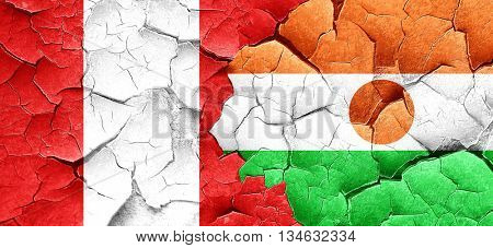 Peru flag with Niger flag on a grunge cracked wall