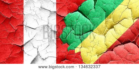 Peru flag with congo flag on a grunge cracked wall