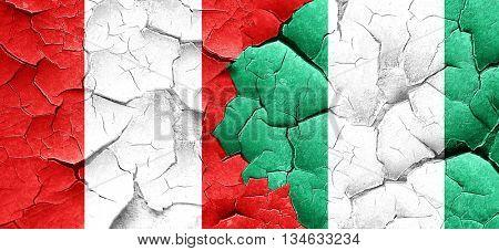 Peru flag with Nigeria flag on a grunge cracked wall