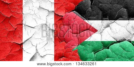 Peru flag with Palestine flag on a grunge cracked wall