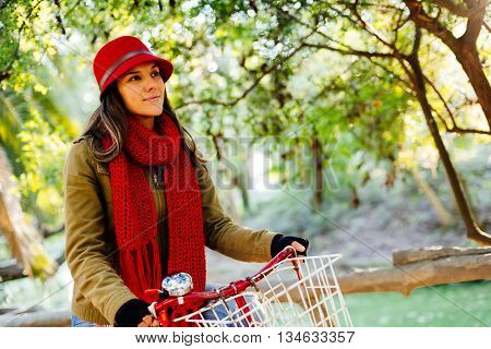 Happy Girl With Bike At Park On Sunny Autumn Day
