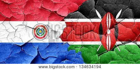 Paraguay flag with Kenya flag on a grunge cracked wall