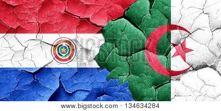 Paraguay flag with Algeria flag on a grunge cracked wall