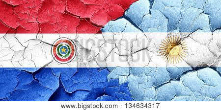 Paraguay flag with Argentine flag on a grunge cracked wall