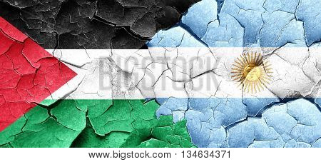 palestine flag with Argentine flag on a grunge cracked wall