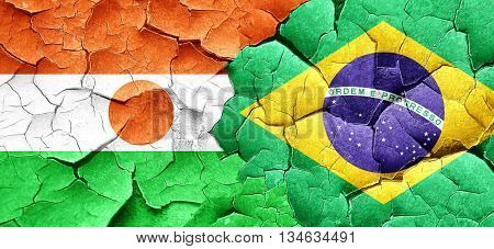 niger flag with Brazil flag on a grunge cracked wall