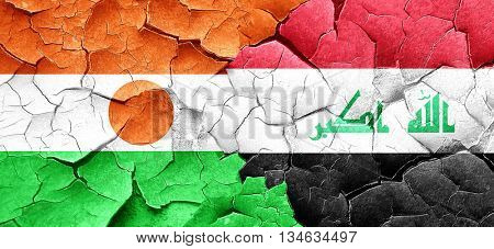 niger flag with Iraq flag on a grunge cracked wall