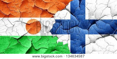 niger flag with Finland flag on a grunge cracked wall