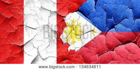 Peru flag with Philippines flag on a grunge cracked wall
