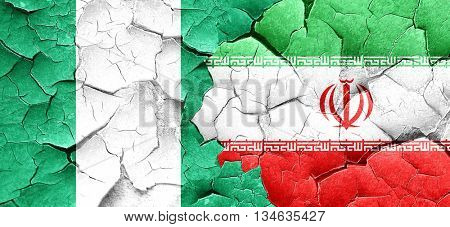 Nigeria flag with Iran flag on a grunge cracked wall