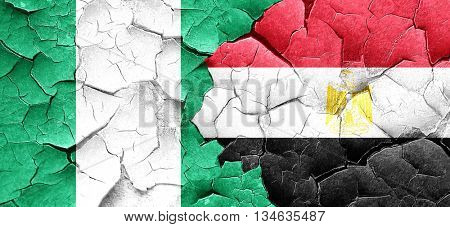Nigeria flag with egypt flag on a grunge cracked wall