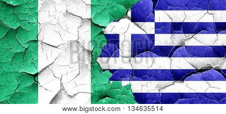 Nigeria flag with Greece flag on a grunge cracked wall