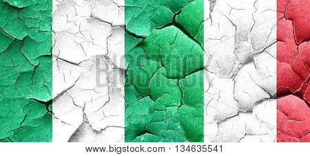 Nigeria flag with Italy flag on a grunge cracked wall