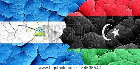 nicaragua flag with Libya flag on a grunge cracked wall