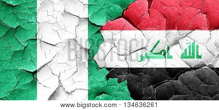 Nigeria flag with Iraq flag on a grunge cracked wall