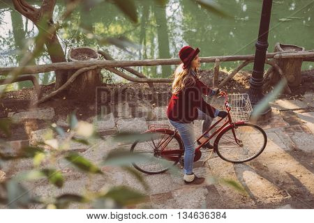 Young Woman Riding Bike On Fall Day From Top Angle
