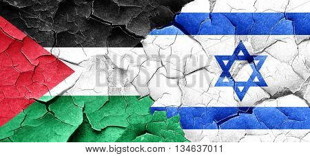palestine flag with Israel flag on a grunge cracked wall