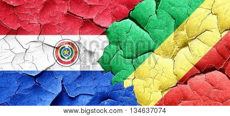 Paraguay flag with congo flag on a grunge cracked wall