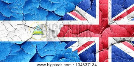 nicaragua flag with Great Britain flag on a grunge cracked wall