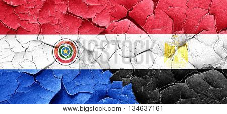 Paraguay flag with egypt flag on a grunge cracked wall