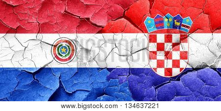 Paraguay flag with Croatia flag on a grunge cracked wall