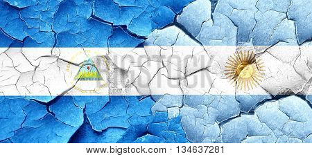 nicaragua flag with Argentine flag on a grunge cracked wall