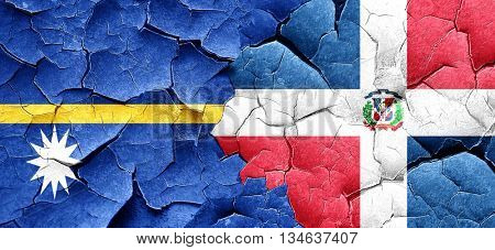 Nauru flag with Dominican Republic flag on a grunge cracked wall