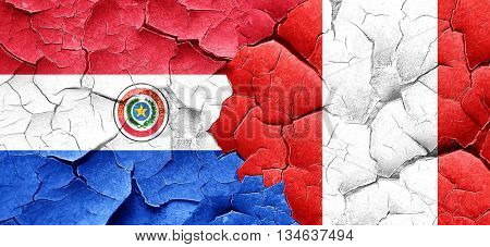 Paraguay flag with Peru flag on a grunge cracked wall