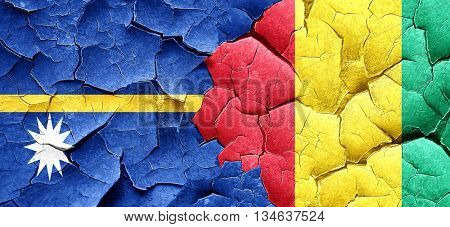 Nauru flag with Guinea flag on a grunge cracked wall