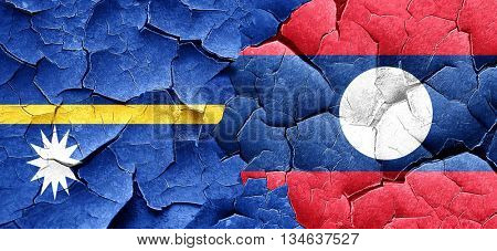 Nauru flag with Laos flag on a grunge cracked wall