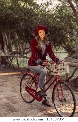 Trendy Fashion Girl Riding Bike On Fall Season