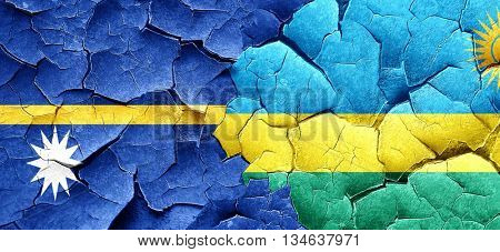 Nauru flag with rwanda flag on a grunge cracked wall