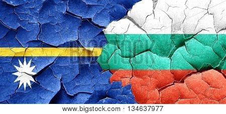 Nauru flag with Bulgaria flag on a grunge cracked wall