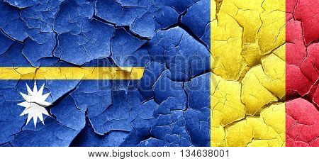 Nauru flag with Romania flag on a grunge cracked wall