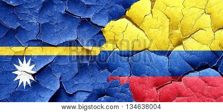 Nauru flag with Colombia flag on a grunge cracked wall