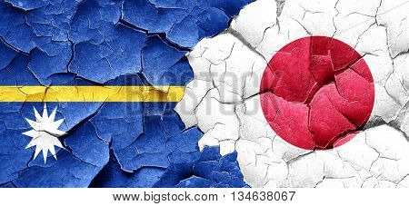 Nauru flag with Japan flag on a grunge cracked wall