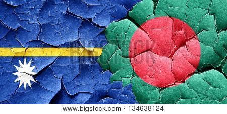 Nauru flag with Bangladesh flag on a grunge cracked wall