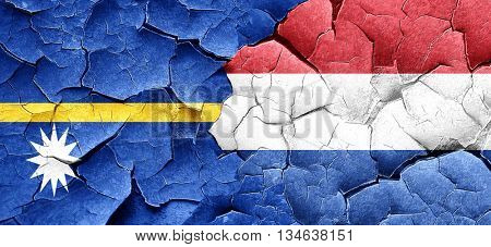 Nauru flag with Netherlands flag on a grunge cracked wall