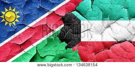 Namibia flag with Kuwait flag on a grunge cracked wall