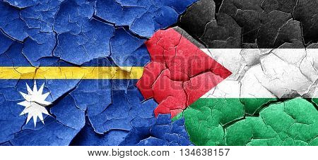 Nauru flag with Palestine flag on a grunge cracked wall