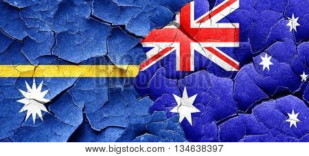 Nauru flag with Australia flag on a grunge cracked wall