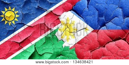 Namibia flag with Philippines flag on a grunge cracked wall